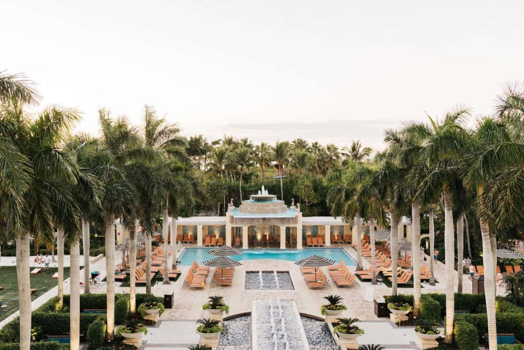 Lush palm trees line the fountains and pool at the Hyatt Regency Coconut Point