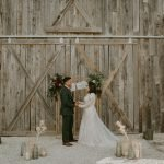 barn wedding ceremony with pampas grass