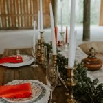 Barn wedding wood sweetheart table with candlesticks and greenery