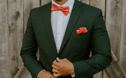 Groom in hunter green suit