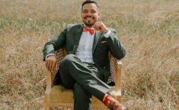 Groom relaxing in vintage boho chair
