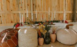Lace draped boho chic sweetheart table in barn