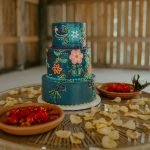 three tiered, bright-colored wedding cake