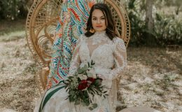 Under the moss covered oak boho bride in lace wedding dress