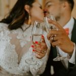 champagne toast and kisses in a barn reception