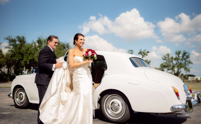 Bride getting out of Rolls Royce