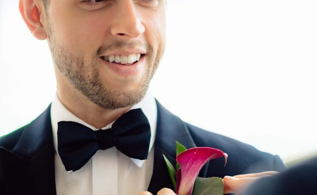 Pinning on Groom's boutonniere