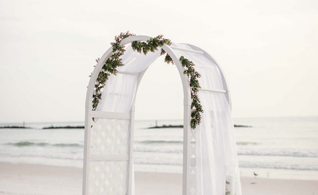 beach wedding ceremony with arch
